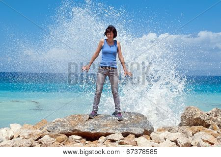 Girl Under The Spray Of Waves