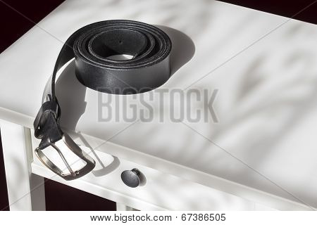 Mens Belt On A Bedstand