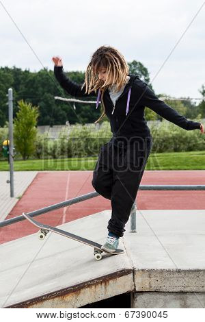 Skate Teen Girl Rides On A Skateboard
