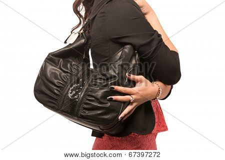 Closeup of woman in black jacket with black leather bag. Isolated on the white studio background.