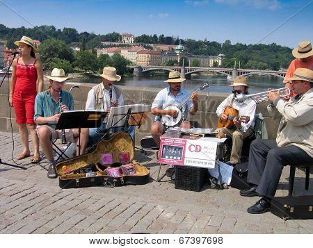 Prague, Czech Republic - June 15, 2006: Orchestra Of Street Musicians Play At Charles Bridge On June