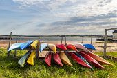 stock photo of kayak  - Colorful kayaks stored along the shore in North Rustico - JPG