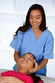 image of chiropractor  - Female chiropractor working at her office with a patient - JPG