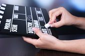 image of clapper board  - Black cinema clapper board in hands - JPG