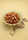 foto of rosary  - Islamic rosary and ornate bowl of dates - JPG
