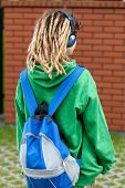 stock photo of dreads  - Girl with dreads going to school and listening music
