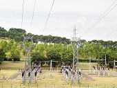 foto of transformer  - power plant with pylons and transformers overhead view