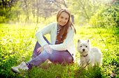 image of west highland white terrier  - a woman with west highland white terrier - JPG