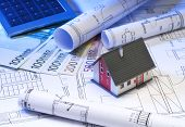stock photo of depreciation  - Architecture model with construction plans and money - JPG