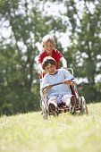 stock photo of karts  - Young boys playing with go - JPG