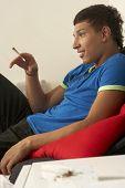image of blunt  - Teenage boy smoking - JPG