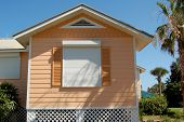 image of hurricane wind  - House windows shuttered for Hurricane season in Florida - JPG