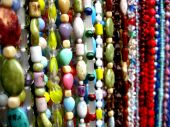 stock photo of collier  - a bunch of necklaces on a flea market - JPG