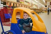 stock photo of grocery store  - Supermarket store little child shopping cart car - JPG