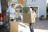 stock photo of moving van  - Family moving house - JPG