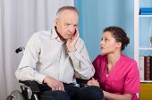 pic of grieving  - Elderly disabled talking with a nurse and grieves - JPG