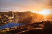 stock photo of cliffs moher  - Famous cliffs of Moher at sunset in Co - JPG