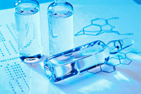 picture of grout  - Vials with grout on a document with structural formula - JPG