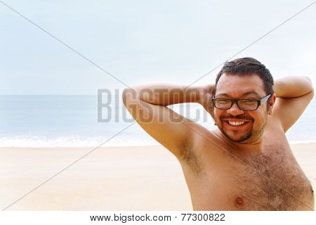 Very happy young man rejoices vacation on ocean coast
