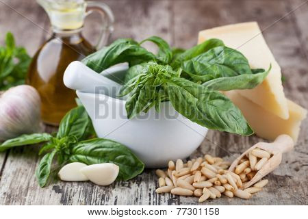 Ingredients for making pesto sauce on the kitchen table