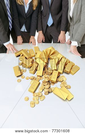 Meeting with people around a table with golden ingots and coins
