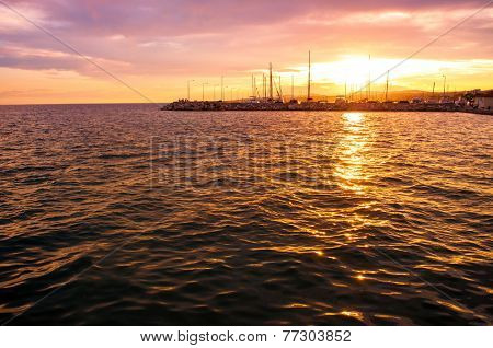 Sunset over Nikiti port with copy-space on the sea surface
