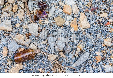 Image Of Bottle And Rock On Ground