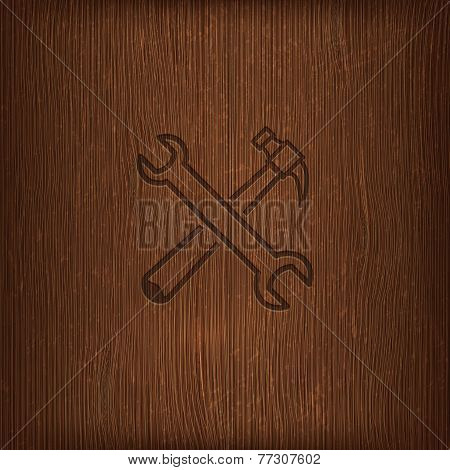 vintage illustration with a hammer and a wrench icon on wood background