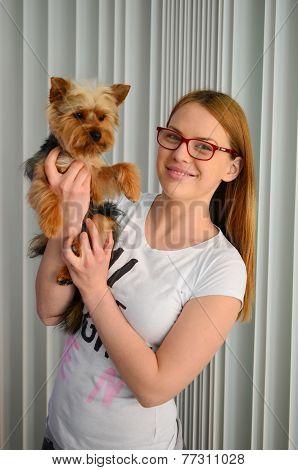 Girl Holding Yorky Dog