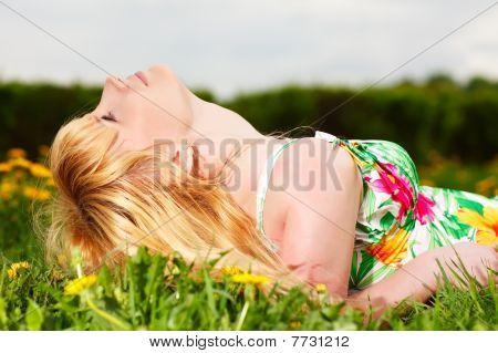 Beautiful Girl Lying Down Of Grass