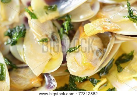 fried beam clams in olive oil close-up