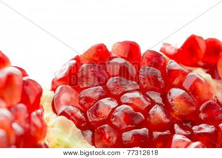 Close up of an organic pomegranate fruit isolated - Shallow DOF