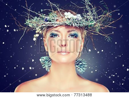 Christmas fashion model girl with snowy wreath on the head
