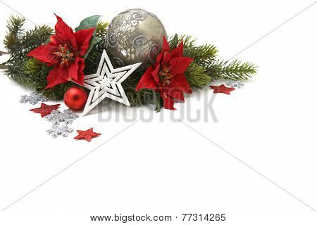 Christmas Decoration of baubles, green branches and flowers