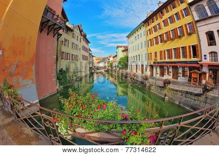 ANNECY, FRANCE - SEPTEMBER 17, 2012: Charming old town of Annecy in Provence. Clear early in the morning. Bridge over the canal is decorated with flowers