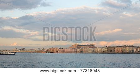 Picturesque City Landscape With A Cloudy Sky, River, Ship, And Historic Buildings. Russia, St. Peter