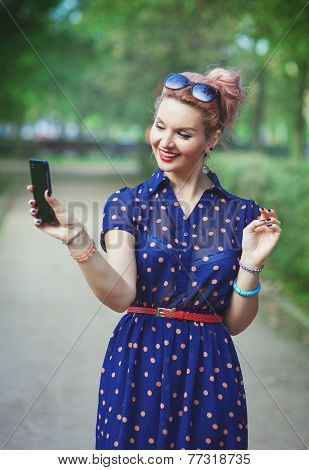 Beautiful Woman In Fifties Style With Braces Taking Picture Of Herself