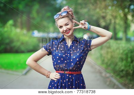Beautiful Woman In Fifties Style With Braces Winking