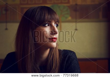 Young Beautiful Woman Looking Into Window In Restaurant