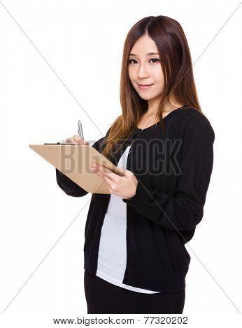 Woman write on clipboard