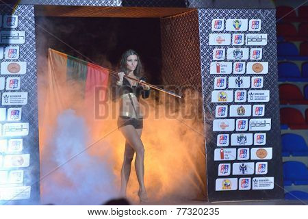 NOVOSIBIRSK, RUSSIA - NOVEMBER 29, 2014: Girl with the flag of Argentina introduce the boxer Carlos Aquino during AIBA Pro Boxing tournament. The winners will go to the Olympics-2016