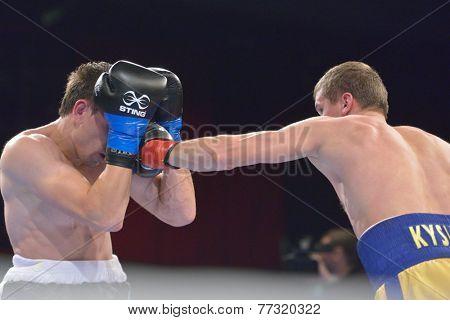 NOVOSIBIRSK, RUSSIA - NOVEMBER 29, 2014: Match Boris Georgiev (left) of Bulgaria vs Viacheslav Kislitsyn of Ukraine during AIBA Pro Boxing tournament. The winners will go to the Olympics-2016