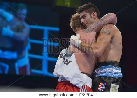 NOVOSIBIRSK, RUSSIA - NOVEMBER 29, 2014: Evaldas Petrauskas of Lietuva (left) greeting Carlos Aquino of Argentina after the match during AIBA Pro Boxing tournament. The winners will go to the Olympics