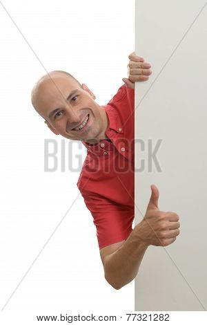 Man Peeking Behind The Blank Poster