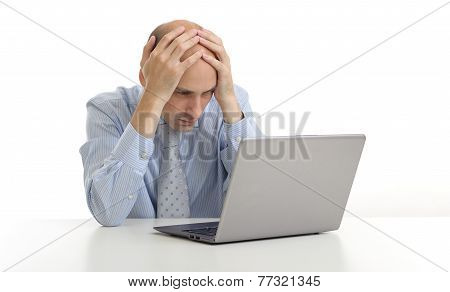 Worried Businessman Looking At His Laptop