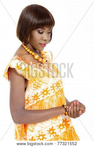 Beautiful Young African Woman Dressed in Traditional Outfit, Isolated on White Background