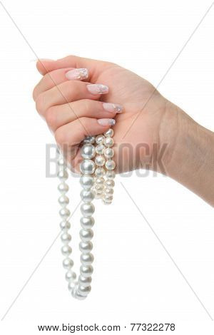 Woman's Hand Holding Pearl Necklaces
