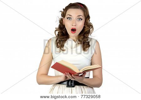 Photo of  surprised pinup woman reading book