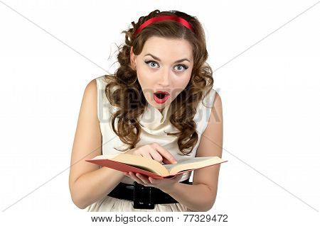 Image of surprised pinup woman reading book