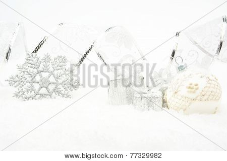 Silver Christmas Baubles,gifts,snowflake With Silver Ribbon On Snow